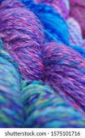 Textured, Hand Spun Yarn In Green, Purple, Pink, And Blue - Diagonally Positioned, Full Screen