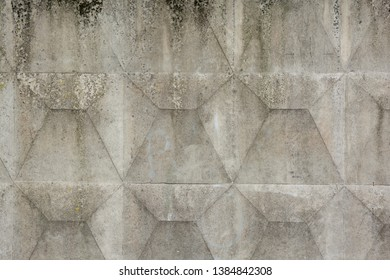 Textured of a old concrete slab. Fragment of concrete slab with a regular prismatic