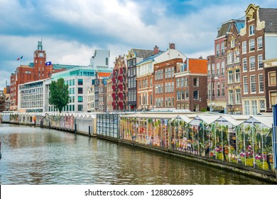 Textured old paper background with Amsterdam street traditional ancient dutch colorful buildings and flower market on Single canal, Netherlands