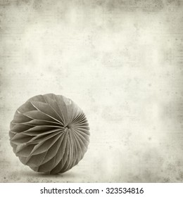 textured old paper background with paper ball ornament