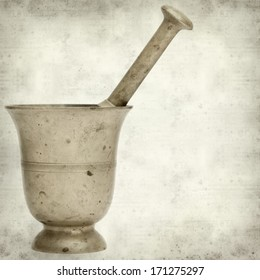 textured old paper background with copper mortar and pestle