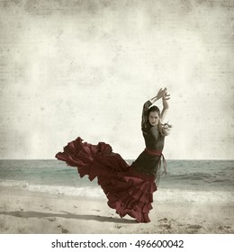 textured old paper background with flamenco dancer by the ocean shore