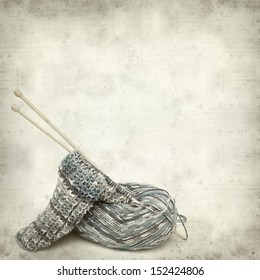 textured old paper background with knitting