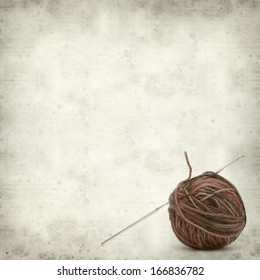 textured old paper background with knitting yarn