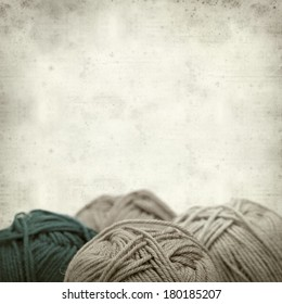 textured old paper background with knitting wool
