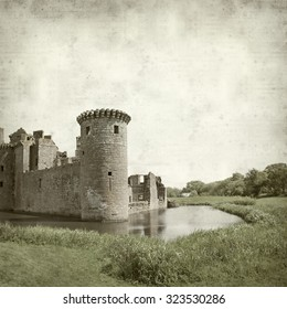 textured old paper background with Moated Caerlaverock Castle, Scotland