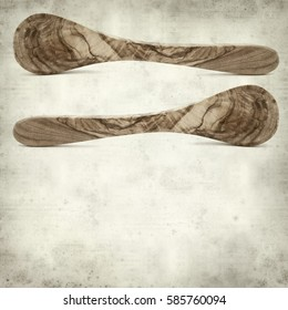 textured old paper background with olive wood spoons