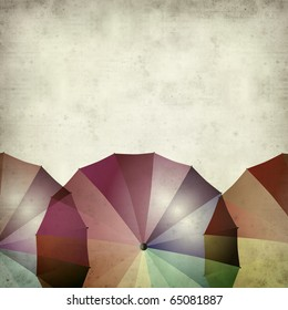 textured old paper background with ovelpapping colorful umbrellas