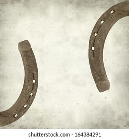 textured old paper background with rusty horseshoe