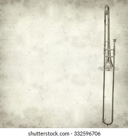 textured old paper background with silver trombone