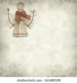 textured old paper background with straw angel