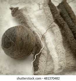 textured old paper background with thin variegated knitting wool