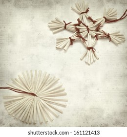 textured old paper background with traditional straw Christmas ornaments