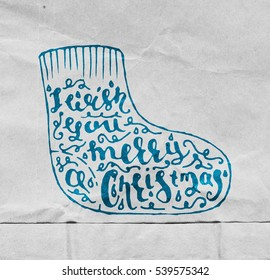 textured old paper background with. Merry Christmas Brush Script Style Hand lettering.