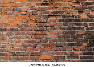 Textured old red brick wall background