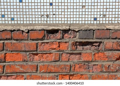 Textured old surface of the original brick wall