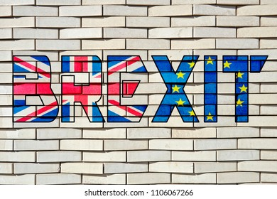 Textured and patterned white brick blocks wall with Brexit letters