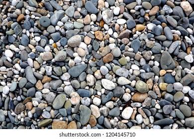 Textured pebbles on a beach