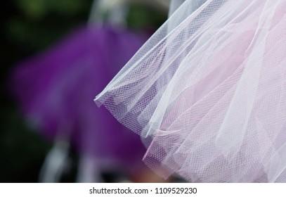 Textured pink dress fabric at art fair
