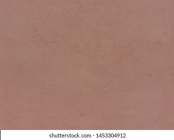Textured plaster in terracotta color. High resolution seamless texture of stucco for background, pattern, poster, collage, gift wrap, wallpaper, photo layering etc.