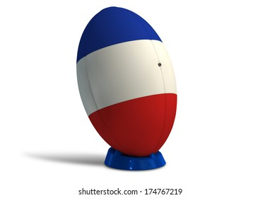 A textured rugby ball in the colors of the french national flag on a kicking tee on a isolated white background