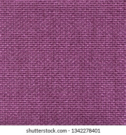 Textured saturated purple mat textile background. Vintage fashion background for designers and composing collages. Luxury textured genuine fabric of high and natural quality.