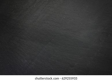 Textured slate board for dishes - black stone background