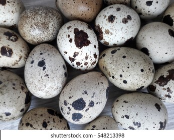 Textured spring background with small quail eggs. Eco products. Horizontal  format