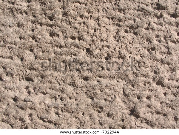 Textured stone in wall of townhouse
