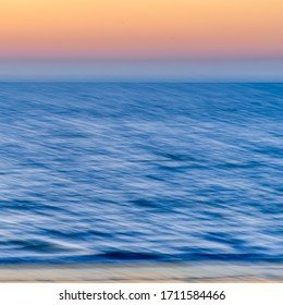 textured sunset over the sea with orange sky. blurred motion - Abstract