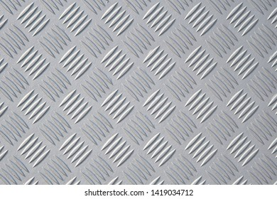 textured surface of a metal checker plate