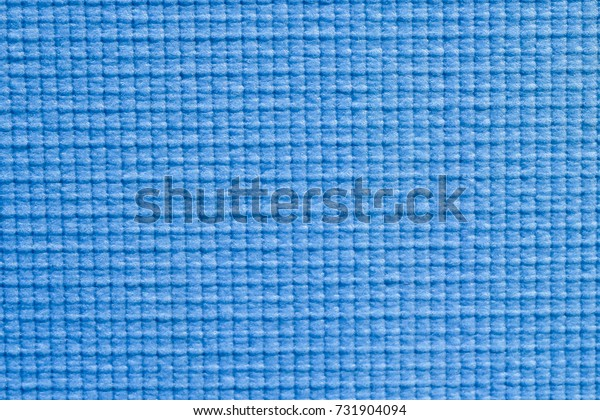 Textured surface on rubber sheet