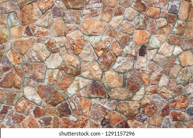 Textured of surface stone wall for background. Tone orange, brown and red color same rust.