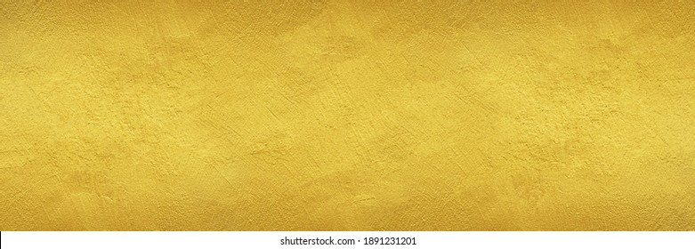 textured wall painted with gold color - wide banner or header format golden background