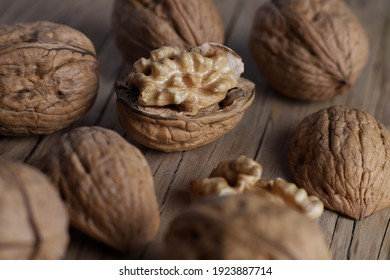 textured walnuts falling on the table