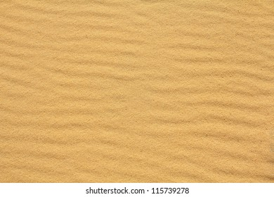 Textured wavy yellow sand all over the frame