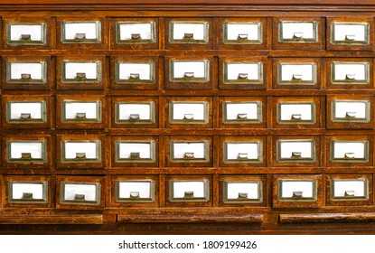 Textured wooden vintage file cabinets with empty spaces for text.