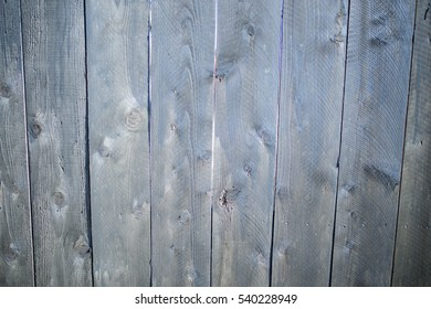 Textured wooden wall with vertical patterns