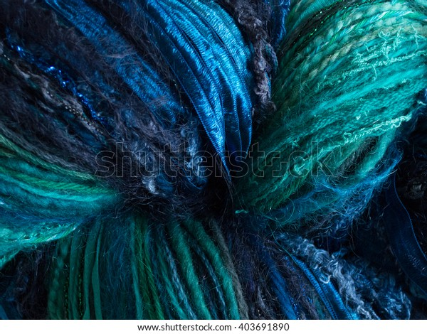 Textured Yarns close up, multiple textures, background, teal blue green, texture