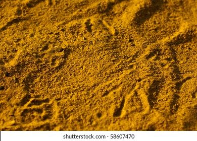 textured yellow sand in summer