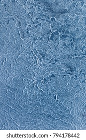 Textures and backgrounds: abstract winter pattern, seasonal background. Flat surface, covered with ice-like crystals of dried salt.