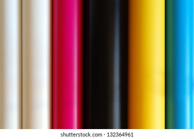 Textures of  colored rolls  placed vertical.