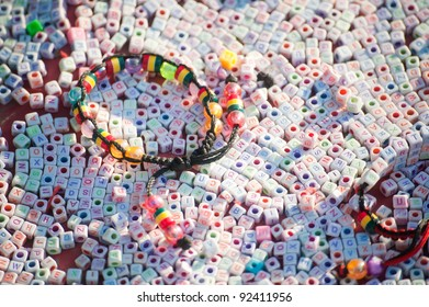 Textures of colorful plastic bracelet on many letter plastic cubic, Nepal.