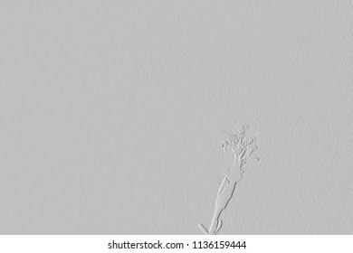 Textures of embossed flowers on background grey