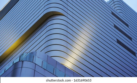 Textures from the facades of night buildings. geometric texture. modern architecture, illumination. composition of curved shapes
