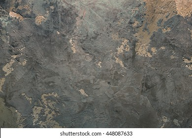 Texturized grey and orange putty. Vintage or grungy background of venetian stucco texture as pattern wall.
