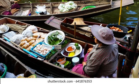 Tha Kha Floating Market, Samut Songkhram, Thailand - October 04, 2015 : The atmosphere of trading goods and food, Unidentified tourists and merchants on vintage boats at Tha Kha Floating Market.