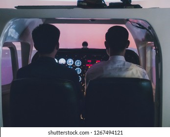 Thai Aerospace Engineering students training in a fixed base flight simulator with flight their upperclassman
