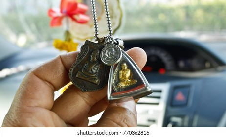 Thai Amulets in car