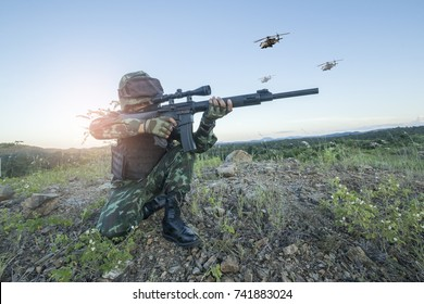 Thai Army rangers with rifle gun in full uniform wit helicopters on sky